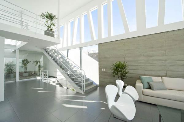 Casa playa el golf h4 by rrmr arqitectos for Decoracion de casas de playa modernas