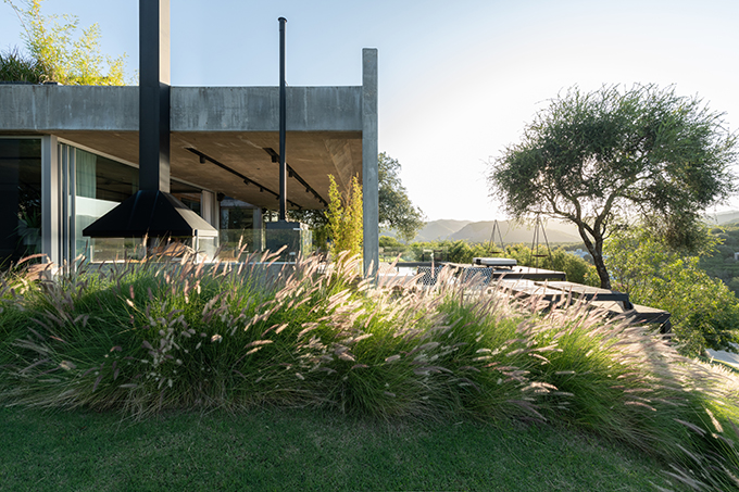 Estudio Herbera designed this stunning single-family residence in Mendiolaza, Córdoba, Argentina. Take a look at the complete story after the jump.